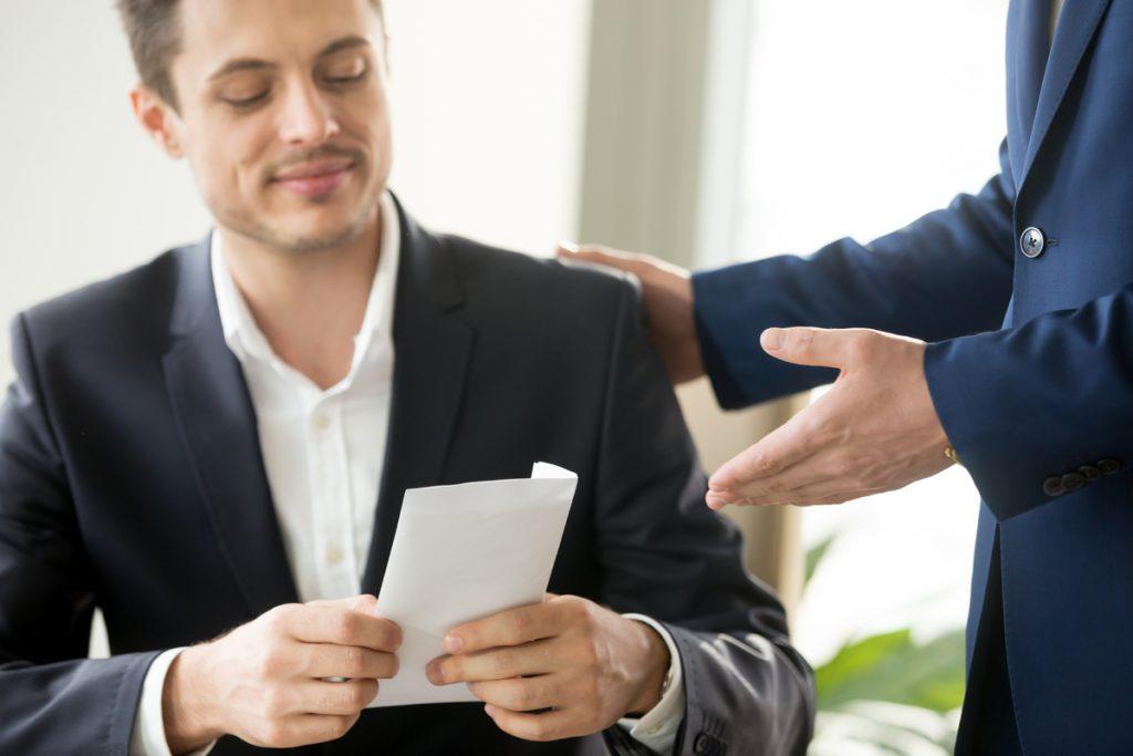 Man receiving a bonus at work.