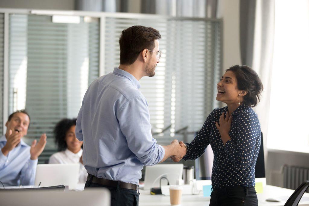 Woman getting praised at work.