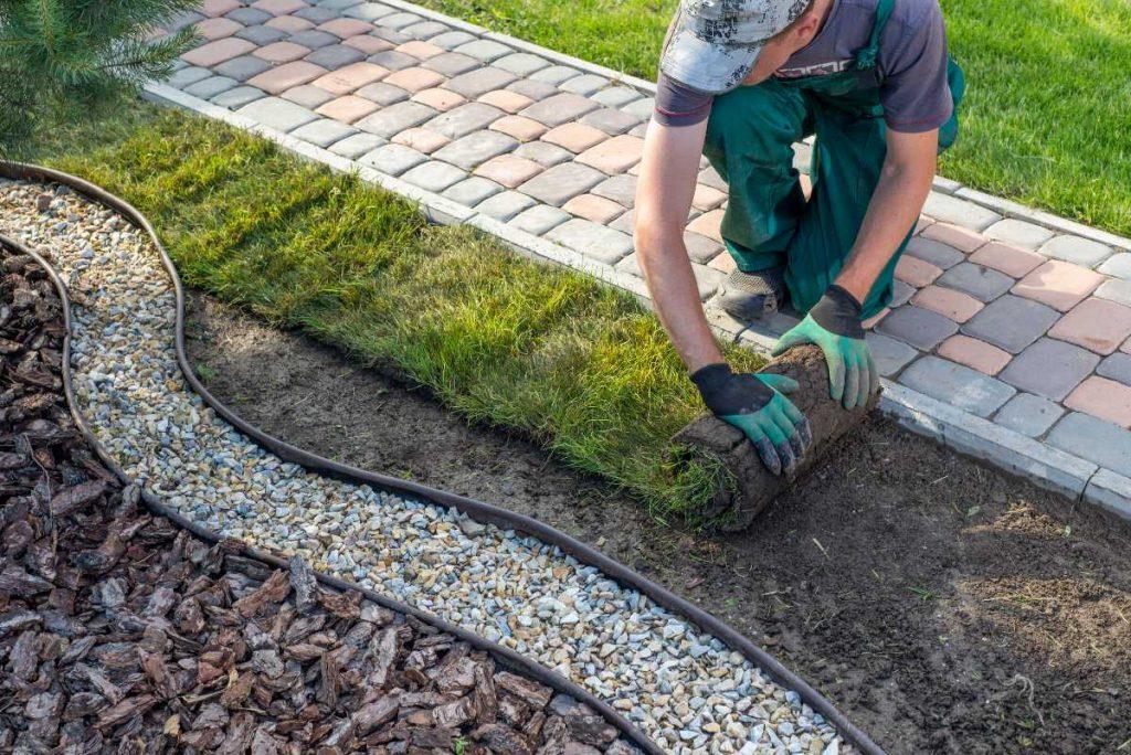 Landscaper spreading new grass.